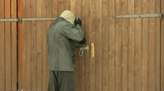 Robber trying to break the  door - stock footage