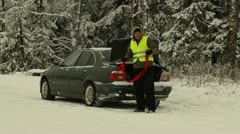 Man with towing rope near car Stock Footage