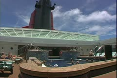 The Queen Mary 2, ocean liner, swimming pool under smoke stack Stock Footage