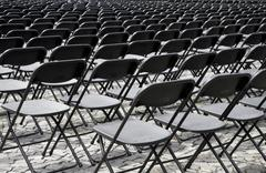 Rows of black auditorium seats - stock photo
