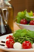 tomato mozarella rocket salad with olive oil and balsmaic vinegar - stock photo