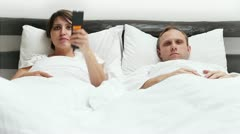 Comic scene - Wife and Husband  TV Remote control conflict in Bed - stock footage