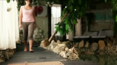 Young woman sit in Yoga breathing pose near Spa Center Pool Stock Footage