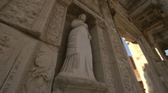 History & culture, Ephesus ruins, The library of Celsus low angle statue Stock Footage