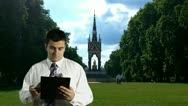 Young Businessman Checking Contract in Hyde Park London Stock Footage