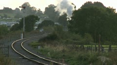 Steam Train Moving Slowly Towards Camera at Sunset Stock Footage