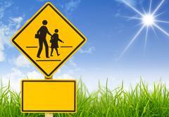 Traffic sign (school warning sign) on grass Stock Illustration