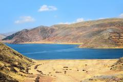 lake and hills in peru - stock photo