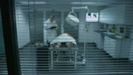 Dead body on an autopsy table being studied by the medical examiner Stock Footage