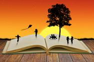 Paper cut of children play on old book Stock Illustration
