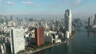 River and skyline of Tokyo at a bright sunny day, Japan's capital city Stock Footage