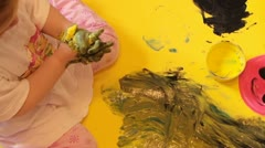 Little Girl Painting With Hands Fun Stock Footage