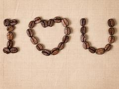 Declaration of love with coffee beans Stock Photos