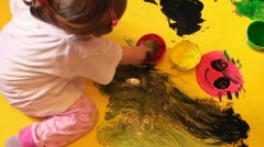 Little Girl Painting With Hands Long Stock Footage