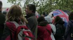 Tourists in the rain waiting for the Diamond Jubilee Pageant Stock Footage