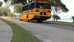 School Bus Driving Down Road 1 Stock Footage