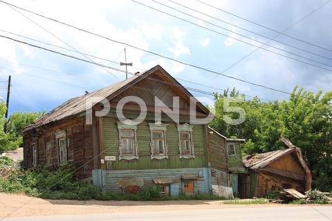 Stock photo of Old wooden house in summer