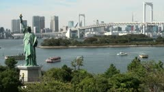 Statue of liberty, replica, Rainbow bridge, skyline, Tokyo, Japan Stock Footage