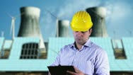 Young Engineer Checking Documents and Signs Energy Concept Stock Footage