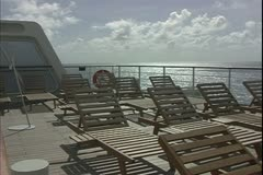 The Queen Mary 2, ocean liner, sailing at sea, empty chaise lounges Stock Footage