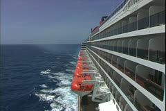 Queen Mary 2, ocean liner, ocean rolling, side view, boat deck and balconies - stock footage