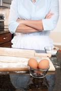 Woman contemplating baking duties Stock Photos