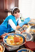 Homemaker washing dishes Stock Photos