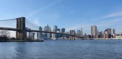 brooklyn bridge and new york skyline - stock photo