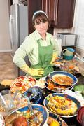 woman washing dishes - stock photo