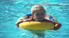 Child in pool 3 Stock Footage