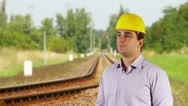 Young Engineer Looking Around Railway Stock Footage