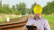 Young Engineer Making Notes Railway Stock Footage
