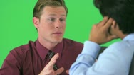 Over the shoulder of two businessmen talking on greenscreen Stock Footage