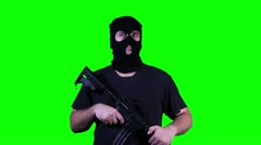 Man in Mask with Gun Watching Greenscreen - stock footage
