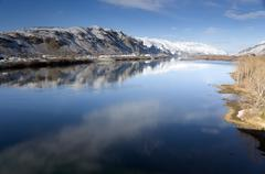 columbia river flows slow after fresh snow - stock photo