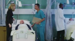 Portrait of a young male nurse on a hospital ward - stock footage