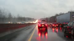 Traffic jam interstate rainy hazardous driving 2 winter storm Stock Footage