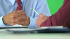 close-up of business hands holding pen on greenscreen - stock footage