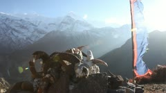 Dried yak skulls in the Himalaya with prayer flags. Stock Footage