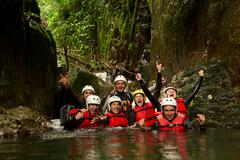 Group Of Active Young People During A Canyoning Expedition In Ecuadorian - stock photo