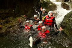 Stock Photo of Group Of Active Young People During A Canyoning Expedition In Ecuadorian