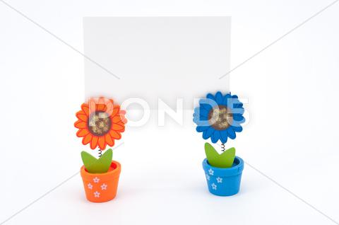 Stock photo of white paper on flower pot