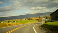Time lapse of a drive through a hilly twisty road during glorious fall Stock Footage