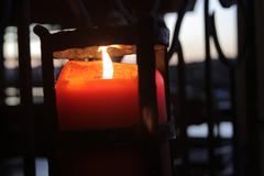 Candle light at dusk Stock Photos