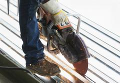 Hispanic man working at construction site Stock Photos