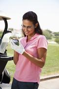Woman keeping score during golf game Stock Photos