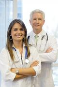 Doctors standing with arms crossed Stock Photos