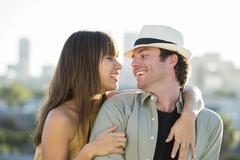 Stock Photo of Smiling couple hugging on city street