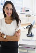Caucasian businesswoman standing at desk Stock Photos