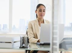 Caucasian businesswoman working on laptop Stock Photos